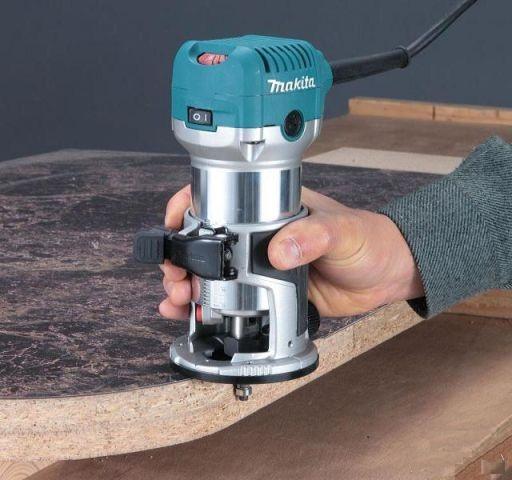 Процесс фрезеровки ручным аппаратом Макита